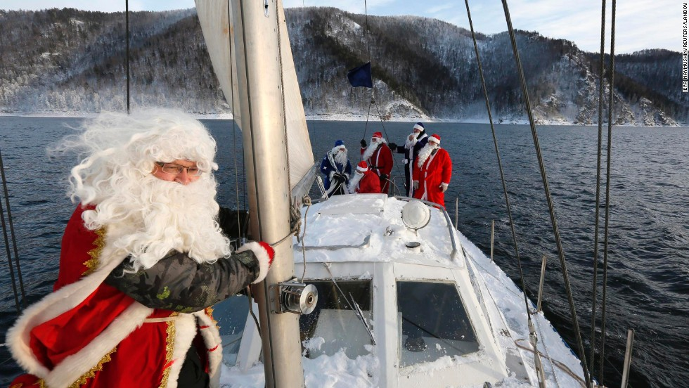"Members of the ""Skipper"" yacht club -- dressed as Father Frost, the Russian equivalent of Santa Claus -- mark the end of the sailboat season Sunday, November 30, outside Krasnoyarsk, Russia. The temperature was minus-18 degrees Celsius (-0.4 degrees Fahrenheit)."
