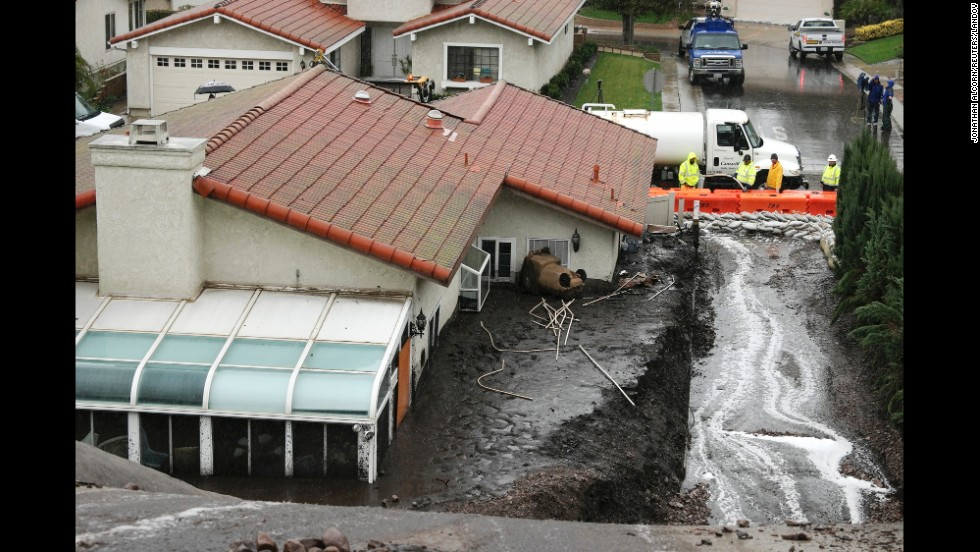 Work crews in Camarillo, California, channel mudflows during a powerful storm on Tuesday, December 2. The area, which struggled with wildfires earlier this year, was under mandatory evacuation orders.