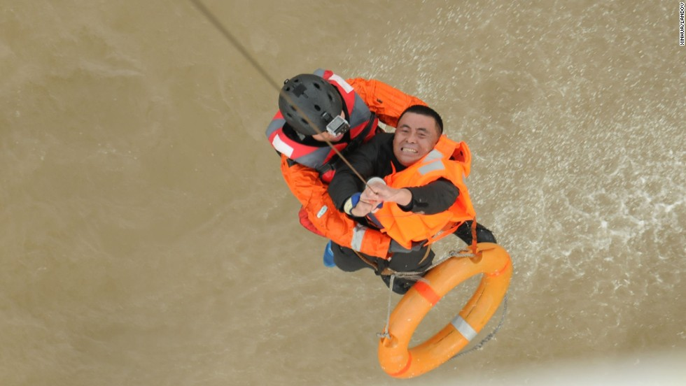 A fisherman is lifted by a rescue helicopter after his vessel capsized near Yantai, China, on Thursday, December 4.