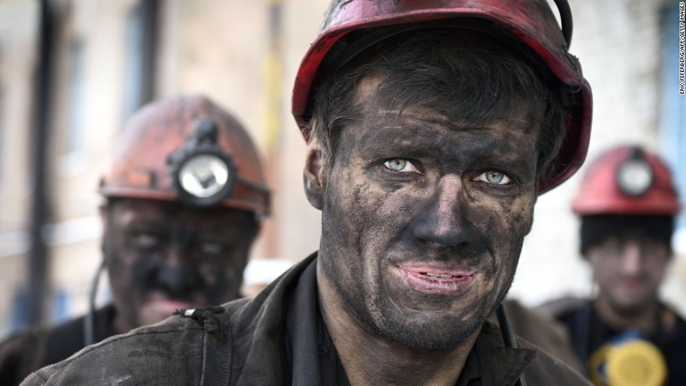 Miners return from their shift at the Kalinina coal mine in Donetsk, Ukraine, on Monday, December 1.