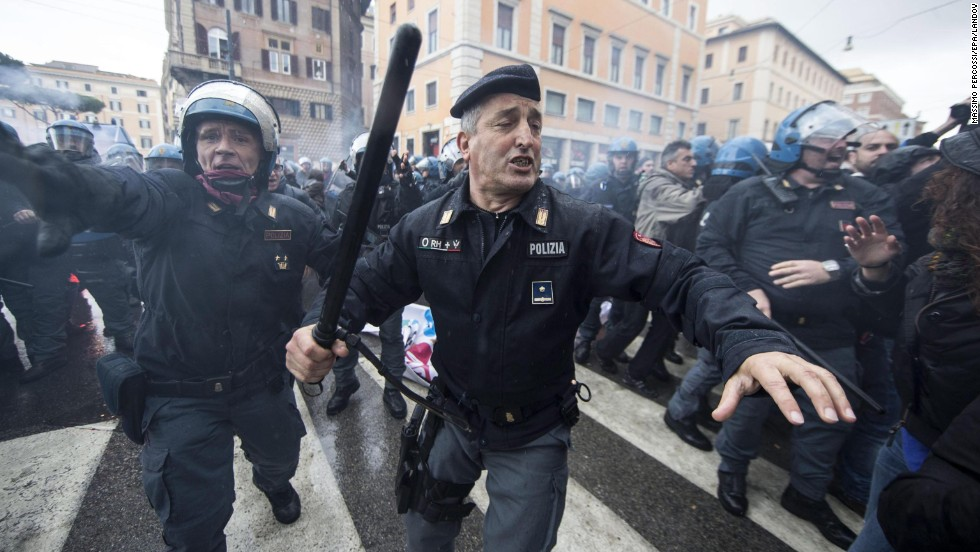 Police in Rome clash with demonstrators Wednesday, December 3, during a rally against the government's labor reform bill.