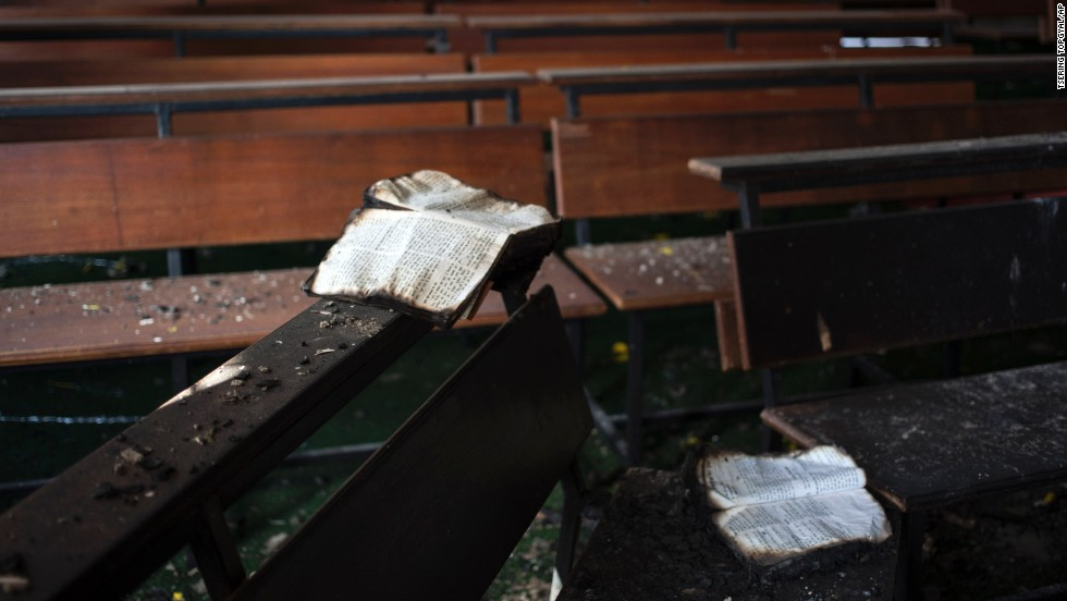 "Burnt Bibles lie on a bench at St. Sebastian's Church in New Delhi after a fire destroyed the church on Monday, December 1. While the cause of the fire is not known, the Delhi Catholic Archdiocese said that ""mischief"" was suspected."