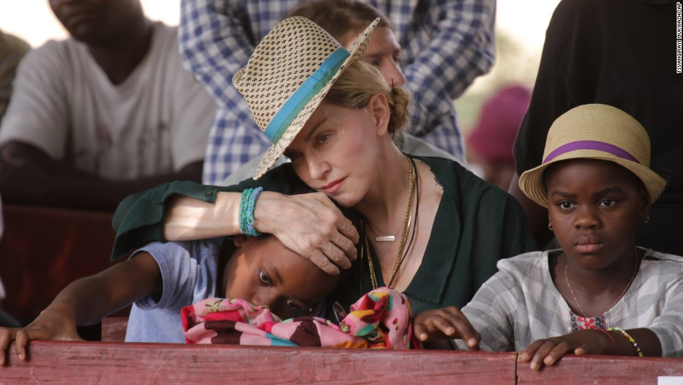 Singer Madonna hugs her son David, left, while her daughter Mercy looks on in Kasungu, Malawi, on Sunday, November 30. The pop icon has a charity organization called Raising Malawi, and she adopted David and Mercy in the country.