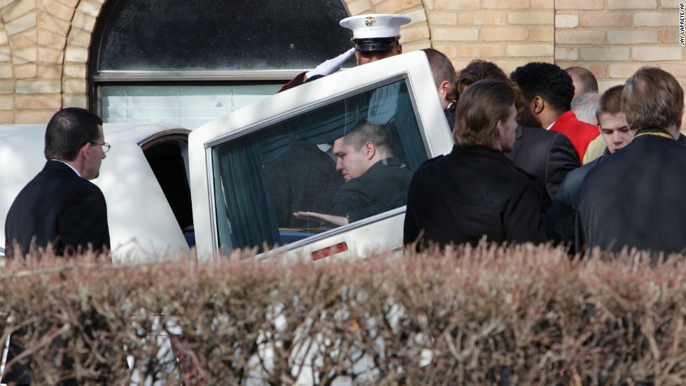 "The casket of Ohio State football player Kosta Karageorge is placed into a hearse after his funeral Wednesday, December 3, in Columbus, Ohio. The 22-year-old, who had been missing since last Wednesday, <a href=""http://www.cnn.com/2014/11/30/us/ohio-state-player-dead/"">was found dead</a> in a Dumpster. Police believe he shot himself."