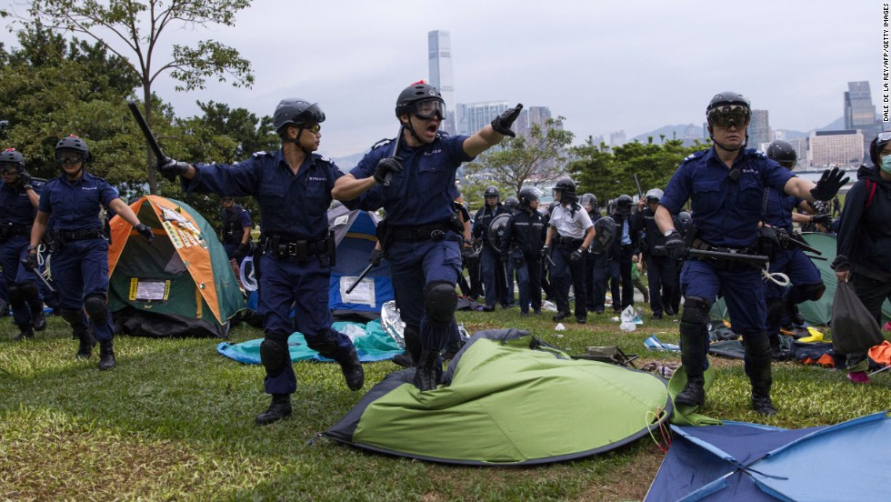 "Police charge into an area used as a campsite by <a href=""http://www.cnn.com/2014/09/22/asia/gallery/hong-kong-students-protest/index.html"">pro-democracy protesters in Hong Kong</a> on Monday, December 1. Demonstrators want to pressure the government to allow open elections for Hong Kong's chief executive in 2017."