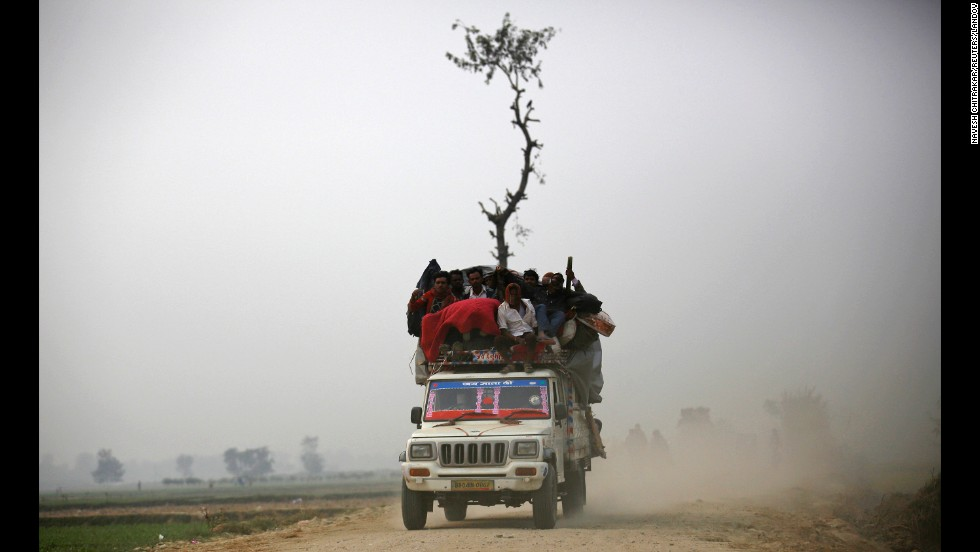 "An overloaded vehicle carries people returning from the Gadhimai Mela festival in Bariyapur, Nepal, on Saturday, November 29. <a href=""http://www.cnn.com/2014/11/28/world/gallery/week-in-photos-1127/index.html"">See last week in 36 photos</a>"