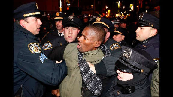 Police make an arrest as protesters march through Manhattan early on December 5.