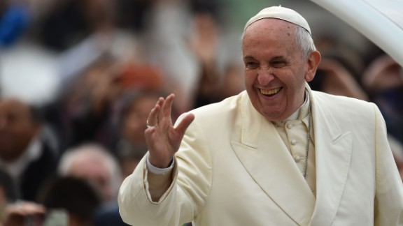 Pope Francis greets the crowd at the end of his weekly general audience December 3 at St. Peter
