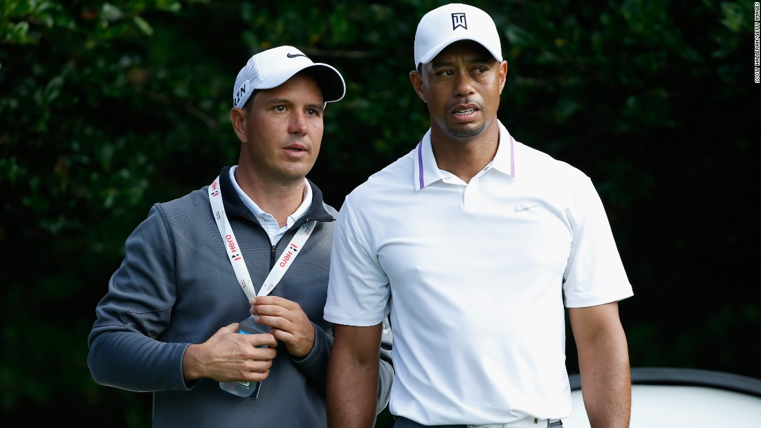 Woods and new swing coach Chris Como are pictured in conversation ahead of the start of the Hero World Challenge in Florida, but the ex-world No.1 has struggled with his game and hit the worst round of his professional career last week.