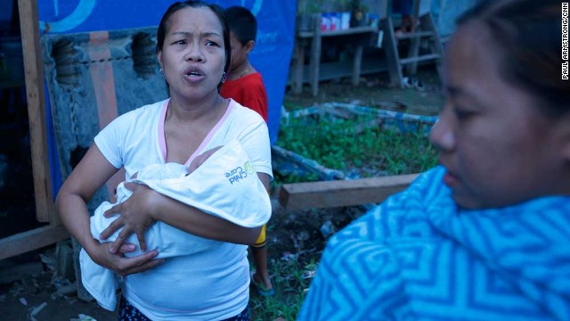 Many of the evacuees are children and babies. This woman and her sister fear their modest home will be destroyed, as was the case last year during Haiyan. But they won't leave Tacloban.