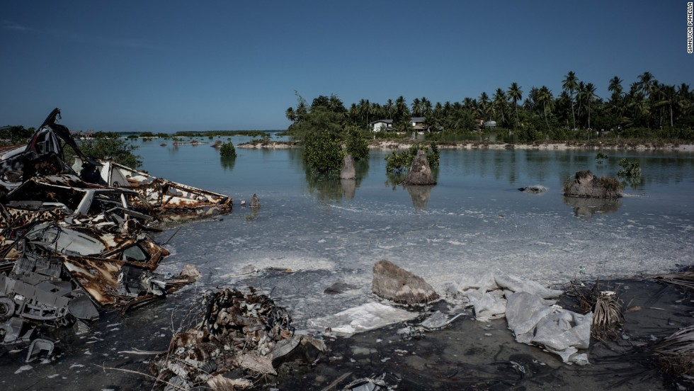 The South Tarawa community of Eita is one of Kiribati's villages most affected by climate change. The rising sea have turned this town's neighborhoods into a maze of contaminated streams and swamps.