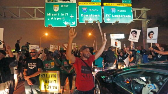 Protesters shut down all eastbound and westbound lanes on Interstate 195, which links Miami Beach to the mainland, on Friday, December 5.