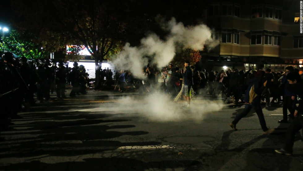 "Demonstrators retreat in Berkeley, California, after police deploy tear gas during a <a href=""http://www.cnn.com/2014/12/07/justice/protests-grand-jury-chokehold/index.html"">protest that turned violent</a> before dawn on December 7."
