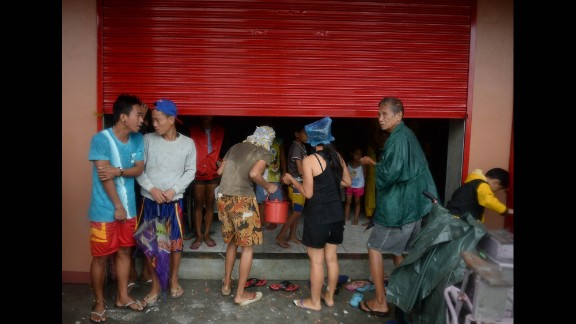 Residents take shelter in an unfinished building hours before Hagupit passes near Legazpi on December 7.