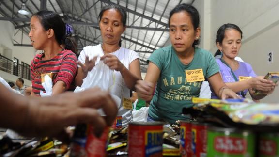 Volunteers repack relief goods in Manila on December 7.