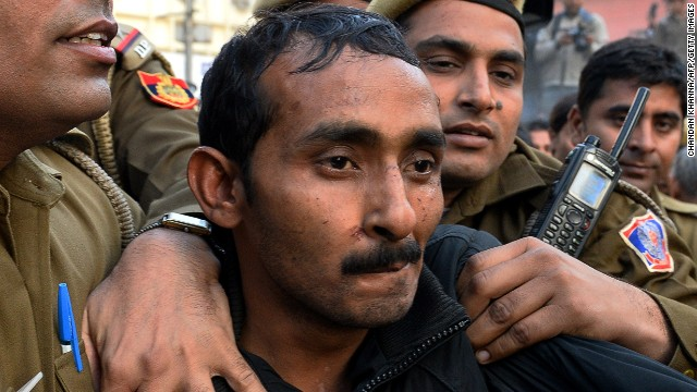 Indian police escort Uber taxi driver and accused rapist Shiv Kumar Yadav following his court appearance in New Delhi on December 8, 2014.