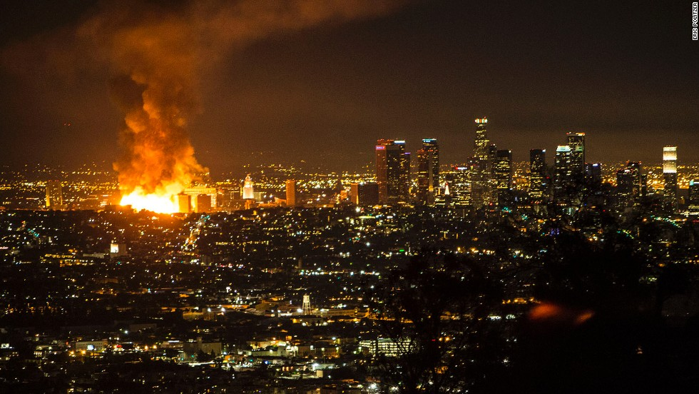 A massive fire engulfs an apartment building that was under construction Monday, December 8, in Los Angeles.