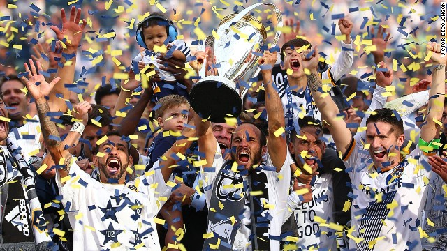 Landon Donovan raises the MLS Cup for the sixth -- and last -- time following LA Galaxy's 2014 victory over New England Revolution.