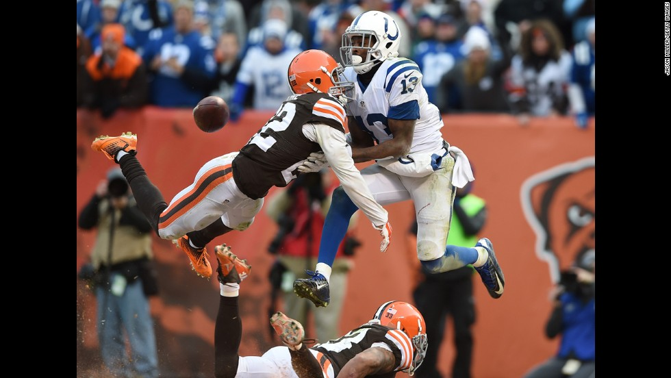 Indianapolis Colts wide receiver T.Y. Hilton, right, can't make a catch as he's defended by Cleveland's Buster Skrine, left, during the Colts' 25-24 victory on Sunday, December 7.