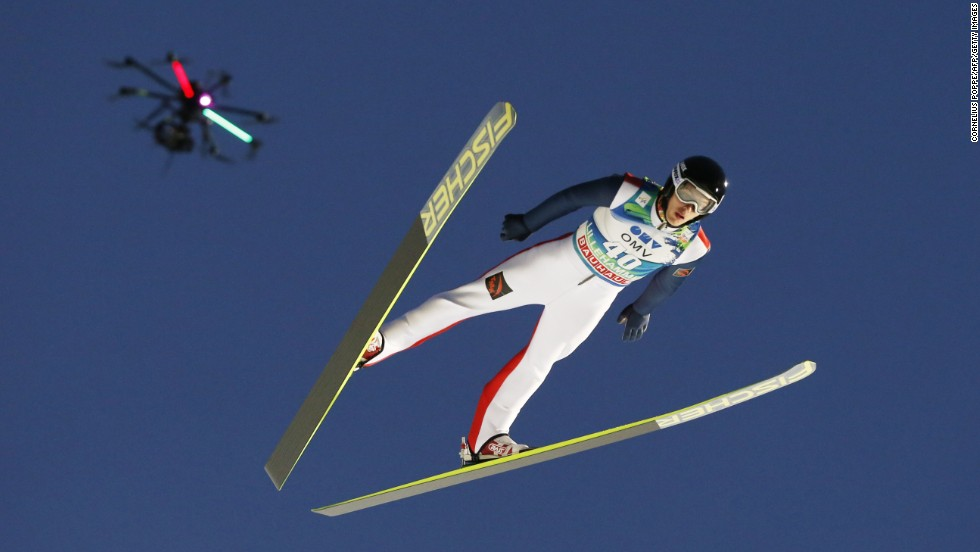 A drone flies over Russian ski jumper Vladislav Boyarinsev as he competes in a World Cup event Sunday, December 7, in Lillehammer, France.