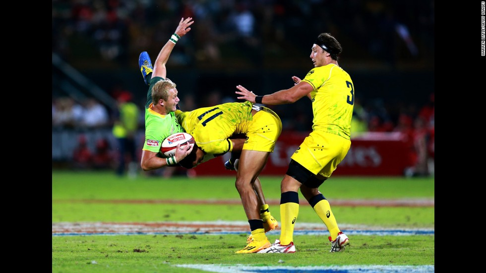 South African rugby player Philip Snyman is slammed by Australia's Pama Fou during a Sevens World Series match played Saturday, December 6, in Dubai, United Arab Emirates. South Africa won the Cup final 33-7.
