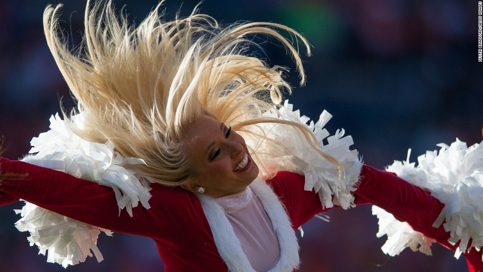A Denver Broncos cheerleader performs in a Christmas-themed outfit during a game on Sunday, December 7.