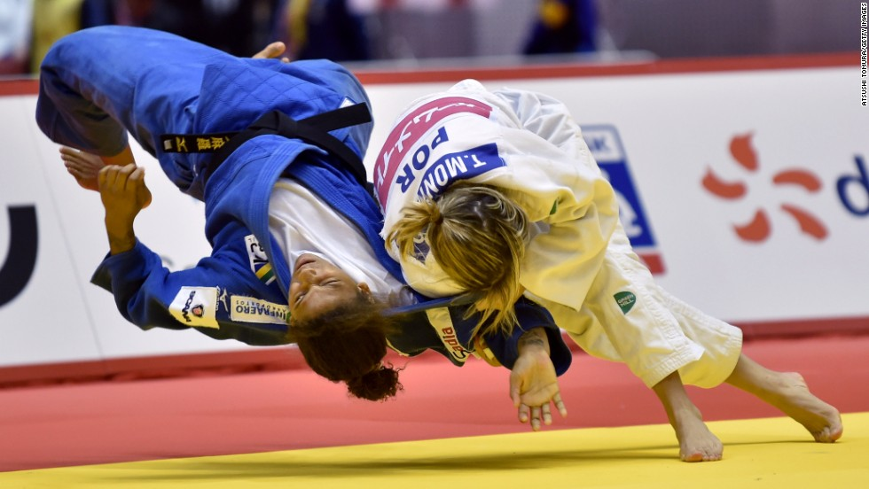 Portugal's Telma Monteiro, in white, throws Brazil's Rafaela Silva during a semifinal match at the Judo Grand Slam Tokyo on Friday, December 5. Monteiro won the match but lost the final of her weight class to Japan's Kaori Matsumoto.