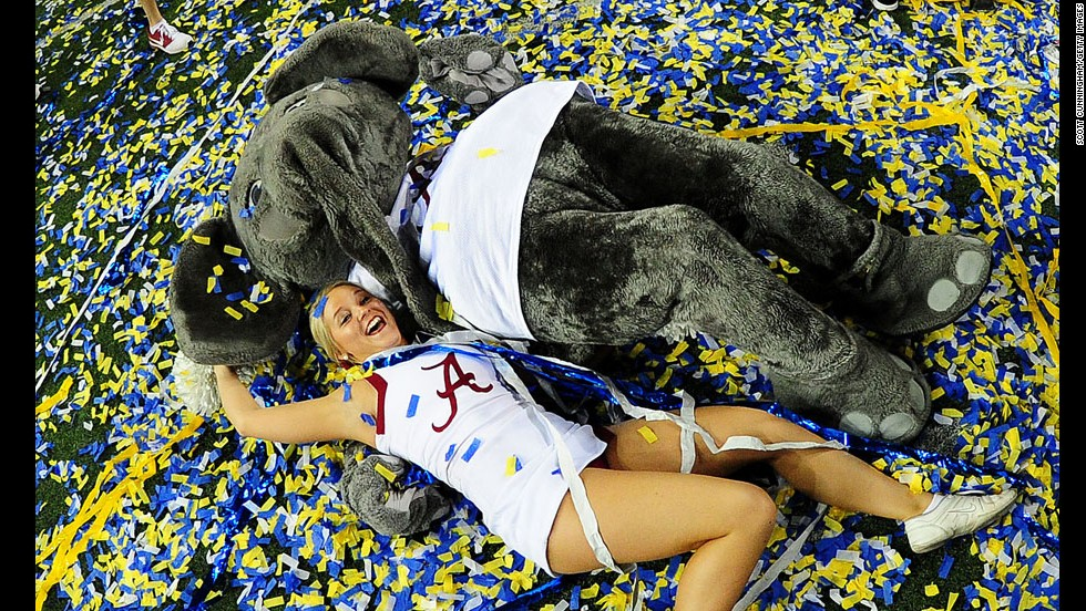 An Alabama cheerleader celebrates with the school's mascot, Big Al, after the Crimson Tide won the SEC football title Saturday, December 6, in Atlanta. Alabama defeated Missouri 42-13 to effectively clinch a spot in the first-ever College Football Playoff.