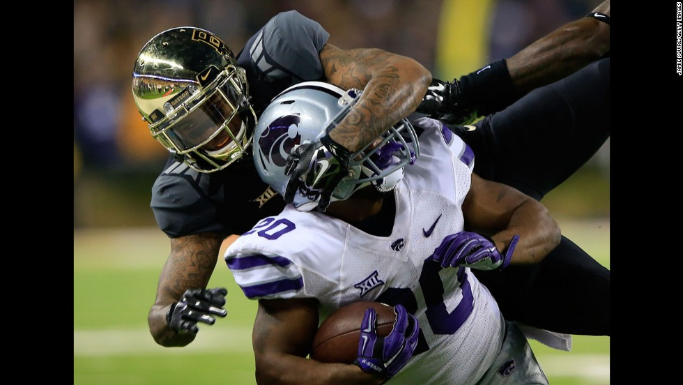 Baylor's Xavien Howard corrals Kansas State running back DeMarcus Robinson during Baylor's 38-27 victory Saturday, December 6, in Waco, Texas. The win clinched a Big 12 conference championship for the Bears, but they just missed out on the College Football Playoff.