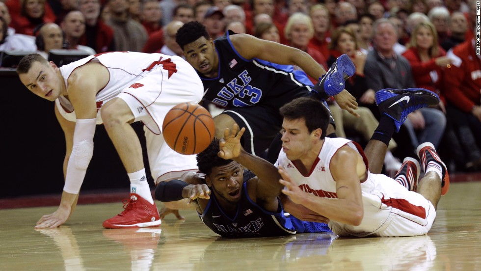 Wisconsin's Duje Dukan, right, and Duke's Justise Winslow slide on the floor for a loose ball Wednesday, December 3, in Madison, Wisconsin. Duke defeated Wisconsin 80-70 to stay undefeated this season.