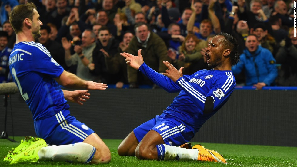 Chelsea's Didier Drogba, right, celebrates with teammate Branislav Ivanovic after scoring against Tottenham on Wednesday, December 3, in London. Chelsea won the home match 3-0 to stay unbeaten in the Premier League.