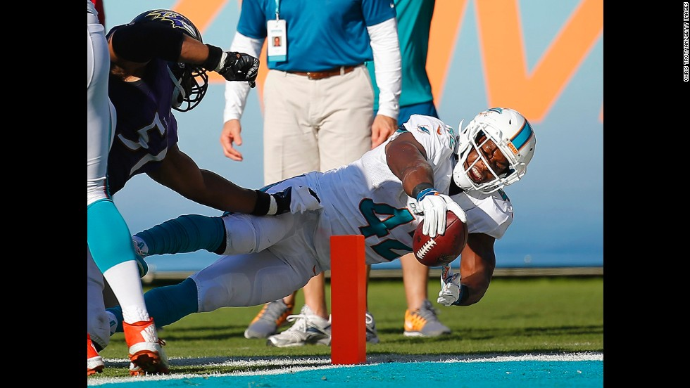 Miami Dolphins tight end Charles Clay reaches for the end zone during a home game against Baltimore on Sunday, December 7. Clay came up short, however, and the Dolphins lost 28-13.