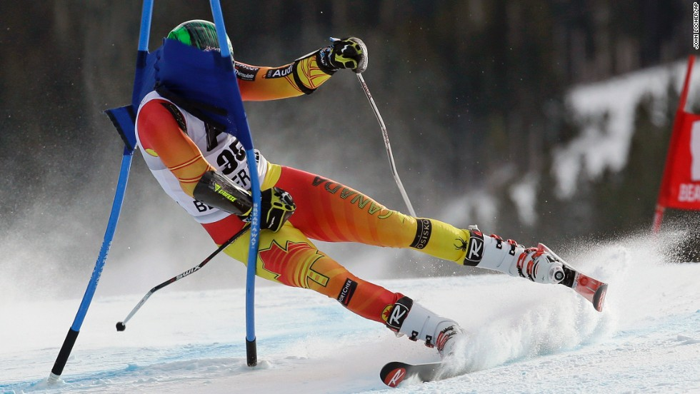 Canadian skier Phil Brown crashes into a gate Sunday, December 7, during the World Cup event in Beaver Creek, Colorado.