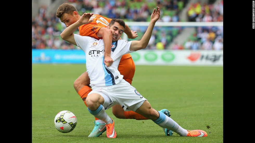 Daniel Bowles of the Brisbane Roar, top, tussles with Benjamin Garuccio of Melbourne City during an A-League match played Sunday, December 7, in Melbourne.