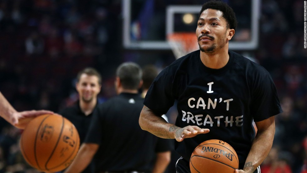 "Derrick Rose, star player for the NBA's Chicago Bulls, wears an ""I Can't Breathe"" T-shirt while warming up for a game Saturday, December 6, in Chicago. The shirt references the words spoken by Eric Garner, a 43-year-old man who died earlier this year after being put in a chokehold by a New York City police officer. After a grand jury decided not to bring criminal charges against the officer, demonstrators across the country <a href=""http://www.cnn.com/2014/12/04/us/gallery/eric-garner-protests/index.html"" target=""_blank"">took to the streets</a> to express their outrage."
