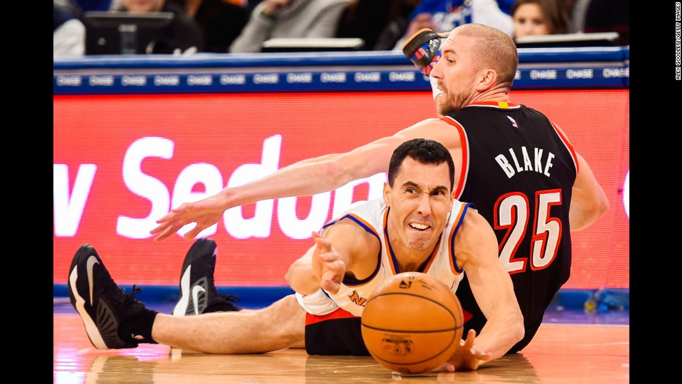"Pablo Prigioni of the New York Knicks dives over Portland's Steve Blake during an NBA game played Sunday, December 7, in New York. <a href=""http://www.cnn.com/2014/12/02/worldsport/gallery/what-a-shot-1202/index.html"">See 31 amazing sports photos from last week</a>"