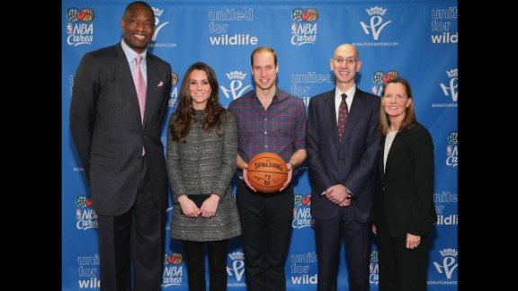 NEW YORK, NY - DECEMBER 08:  Prince William, Duke of Cambridge (C) and Catherine, Duchess of Cambridge (2nd L) pose with NBA Commissioner Adam Silver (2nd R), Global Ambassador Dikembe Mutombo (L) and Sr. Vice President, Community & Player Programs Kathleen Behrens (R) as they attend the Cleveland Cavaliers vs. Brooklyn Nets game at Barclays Center on December 8, 2014 in the Brooklyn borough of New York City.  (Photo by Neilson Barnard/Getty Images)