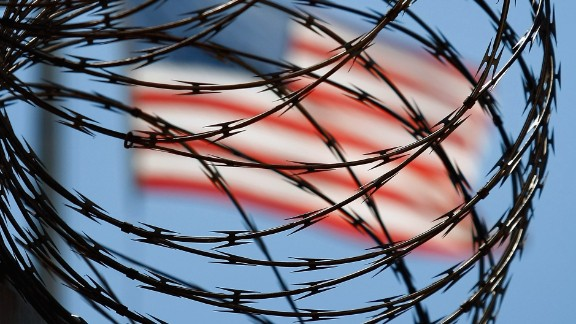 GUANTANAMO BAY, CUBA - OCTOBER 27: (EDITORS NOTE: Image has been reviewed by U.S. Military prior to transmission.) A roll of protective wire rings a detainee camp inside the U.S. military prison for 'enemy combatants' on October 27, 2009 in Guantanamo Bay, Cuba. Although U.S. President Barack Obama pledged in his first executive order last January to close the infamous prison within a year's time, the government has been struggling to try the accused terrorists and to transfer them out ahead of the deadline. Military officials at the prison point to improved living standards and state of the art medical treatment available to detainees, but the facility's international reputation remains tied to the 'enhanced interrogation techniques' such as waterboarding employed under the Bush administration. (Photo by John Moore/Getty Images)