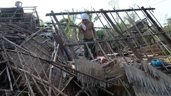 Residents try to salvage materials from destroyed houses in San Julian, Philippines, on December 9.
