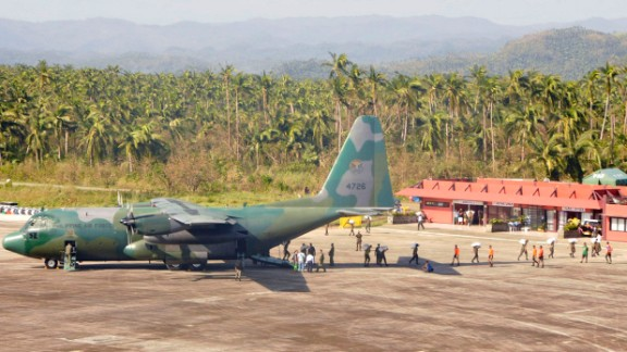 A Philippine air force cargo plane unloads tons of relief supplies in Borongan, Philippines, on December 9.