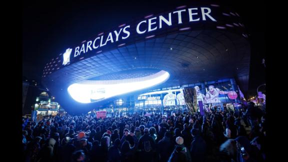 Protesters gather in front of the Barclays Center during an NBA game in New York on Monday, December 8.