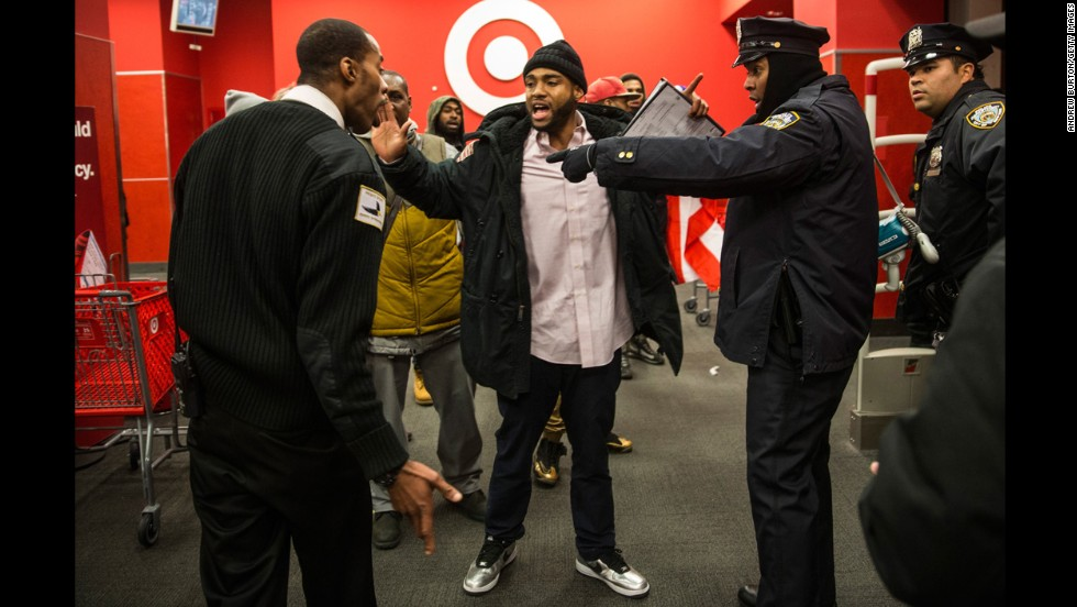Police clash with demonstrators at the entrance of a Target near the Barclays Center on December 8.