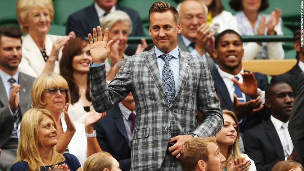 Away from the course, the 38-year-old is still a natty dresser, as proved by this appearance at Wimbledon in 2014.