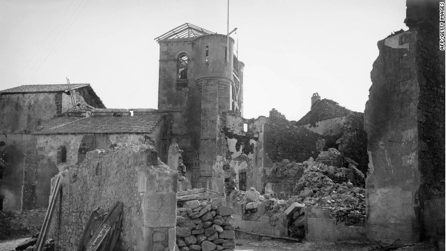 A photo shows the ruins at Oradour-sur-Glane and the church where the village's women and children were killed.