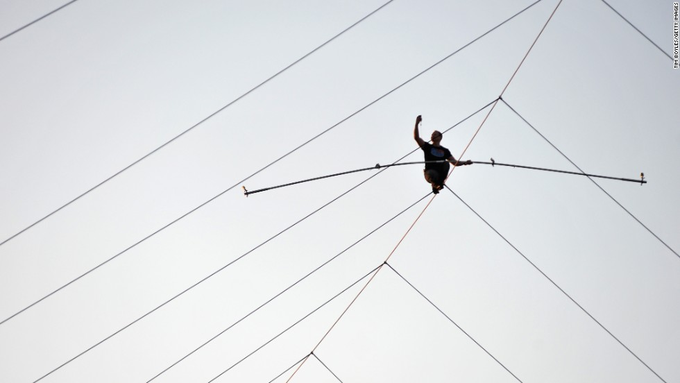 Daredevil Nik Wallenda takes a selfie while walking on a high wire Saturday, December 6, at a car dealership in Sarasota, Florida.