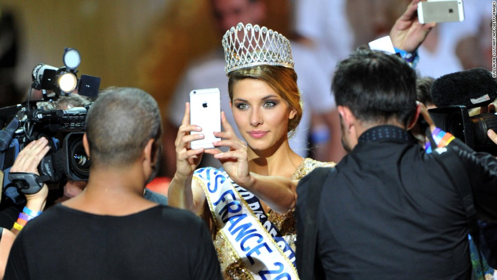 Camille Cerf takes a selfie after winning the Miss France beauty contest Saturday, December 6.