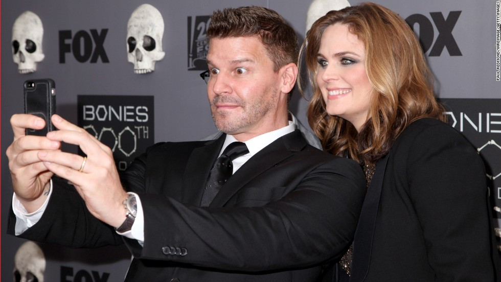 "Actors David Boreanaz and Emily Deschanel pose for a photo on the red carpet as they celebrate the 200th episode of the TV show ""Bones"" on Monday, December 8."