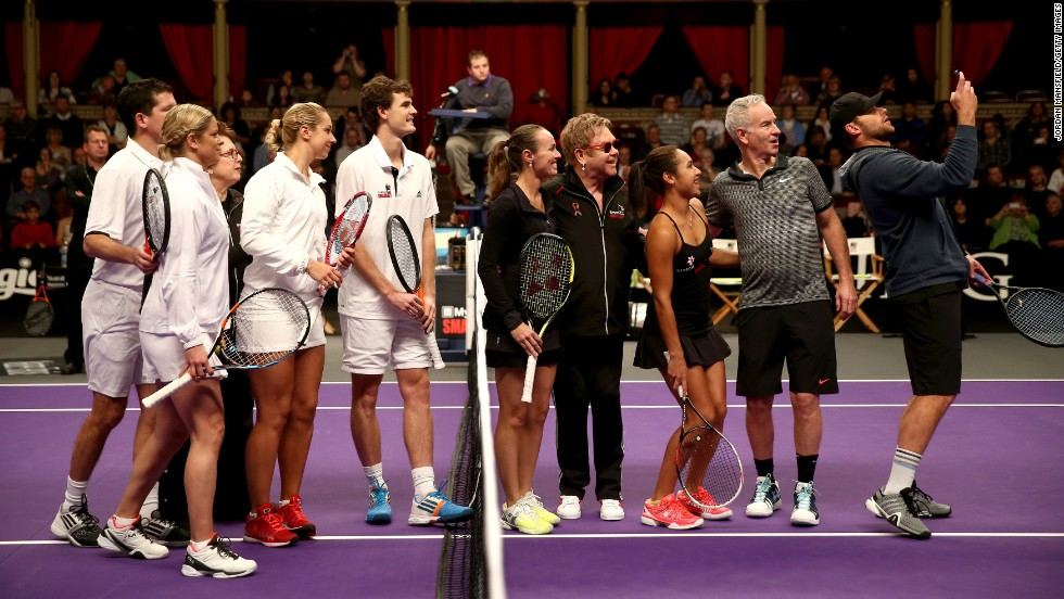 Andy Roddick takes a selfie with other tennis stars -- and even music legend Elton John -- during a World Team Tennis event in London on Sunday, December 7. From left to right are Tim Henman, Kim Clijsters, Billie Jean King, Sabine Lisicki, Jamie Murray, Martina Hingis, John, Heather Watson, John McEnroe and Roddick.<br />