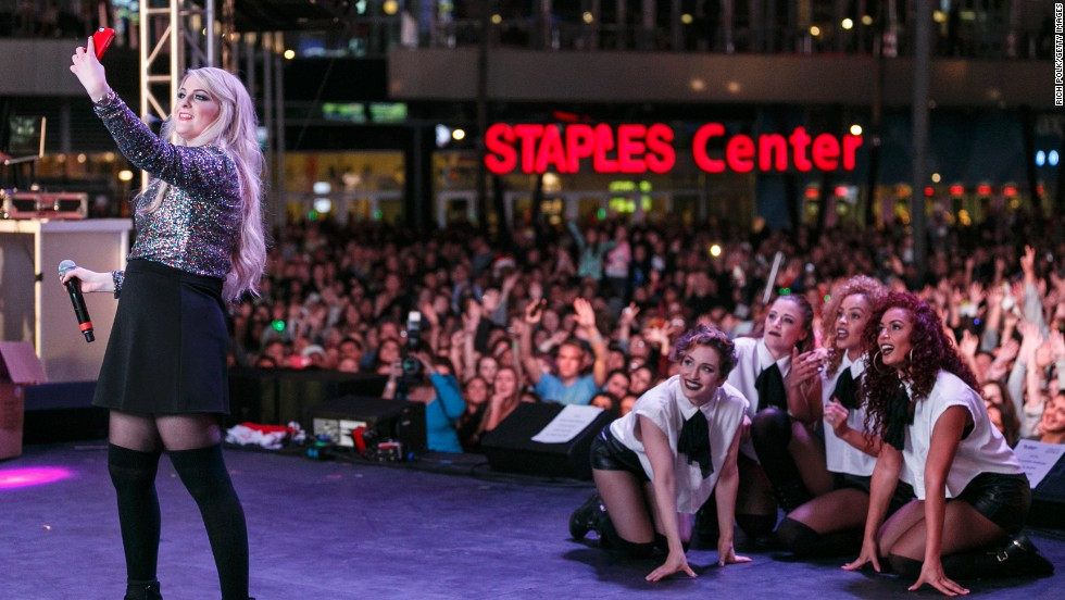 Singer Meghan Trainor takes a selfie on stage at the KIIS FM Jingle Ball Village, an event held outside the Staples Center in Los Angeles on Friday, December 5.