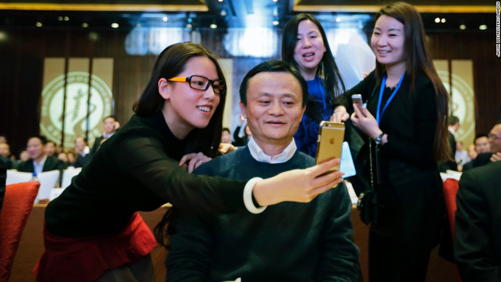 A delegate takes a selfie with Jack Ma, executive chairman of the Alibaba Group, as he arrives in Beijing for a conference of the Zhejiang Chamber of Commerce on Saturday, December 6.